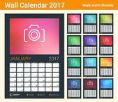 Nástěnné kalendáře Plánovač šablona pro rok 2017. Sada 12 měsíců. Šablona návrhu vektorové s místem pro fotografie. Týden začíná v pondělí. Orientace na výšku. Černé pozadí