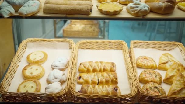 delicious fresh mouth-watering pastries in wicker baskets in a bakery window