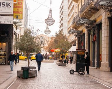 Barrel organ player performing in the city center of Athens