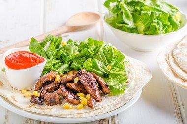 Chicken teriyaki salad on tortilla