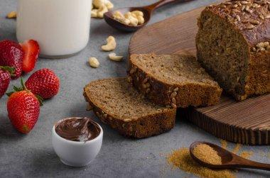 Nutella spread with wholegrain bread, fresh strawberries stock vector