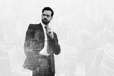 Double exposure with cityscape of business man holding glasses near mouth and looking on something with angry face