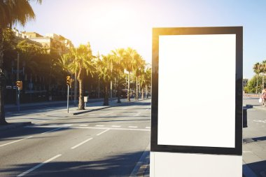 Blank billboard with copy space for your text message or content, outdoors advertising mock up, public information board on city road, flare sun light
