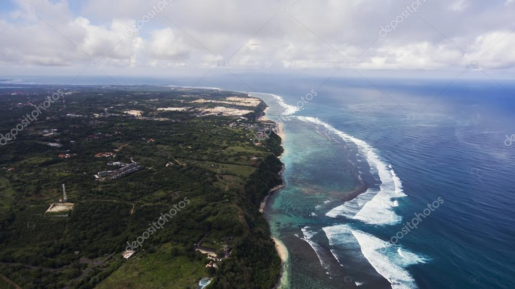 Aerial photo from flying drone of amazingly beautiful landscape of nature with paradise beach and residential area with resort hotels and villas near sea with calm waves