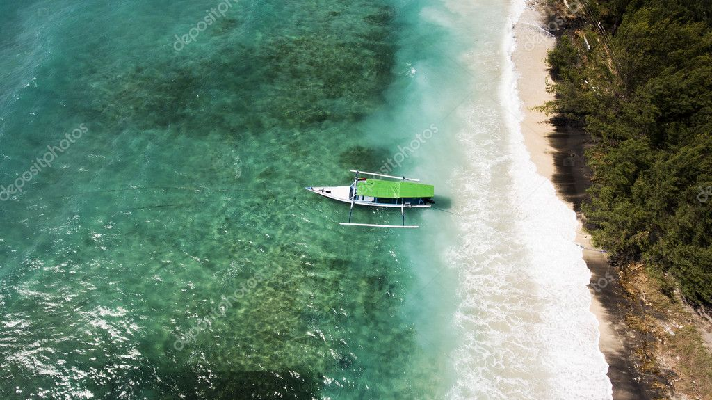 Top view aerial photo from drone of a wonderful nature landscape of Indian Ocean with coral bottom place for snorkeling with masks.