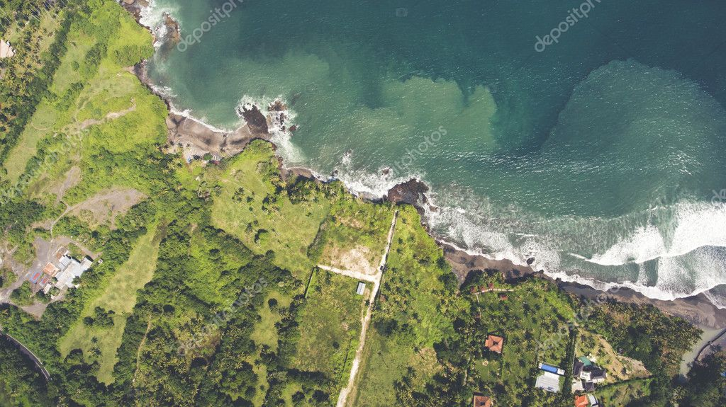 Aerial drone photo top view of the Indian Ocean waves meet or occur with a large white sand beach.