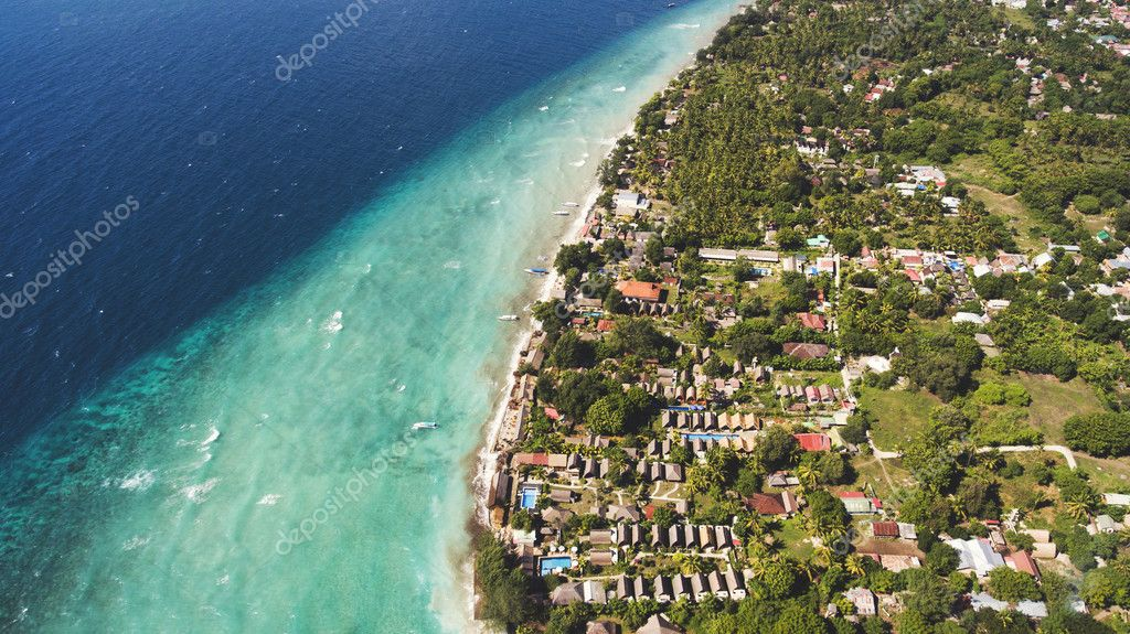 Aerial photo from drone of perfect sand and crystal clear water in a thousand shades of blue all this in Paradise island of Indonesian archipelago