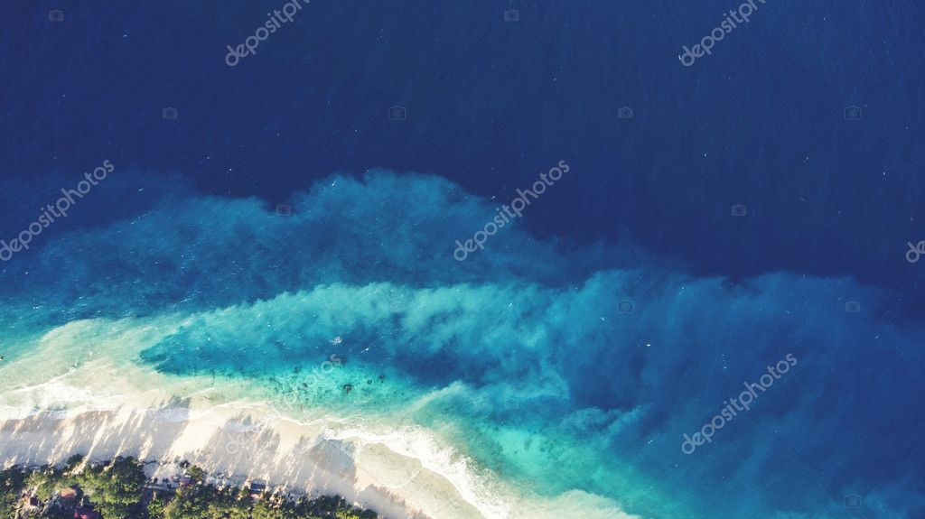 Top view aerial drone photo of fantastically stunning seashore with perfect sand and crystal clear water in a thousand shades of blue