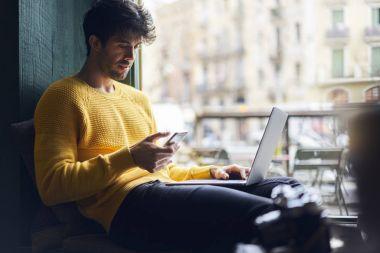 Stylish male freelancer working