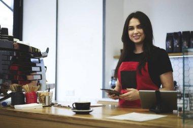 Orofessional female waitress making money transfer for purchasing
