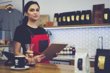beautiful waitress having working day in coffee shop using digital touch pad device