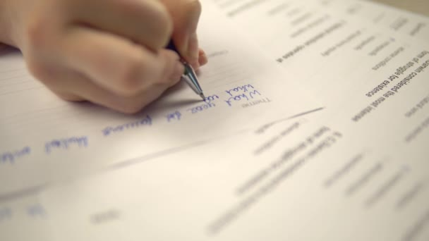 Student taking writing examination, having test at school or college