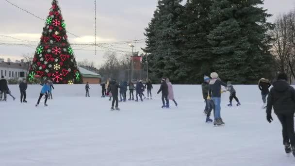 Latvia, Daugavpils - February 2017: Daytime ice skating scene on the ice rink at main square in the city of Daugavpils, Latvia, February, 2017