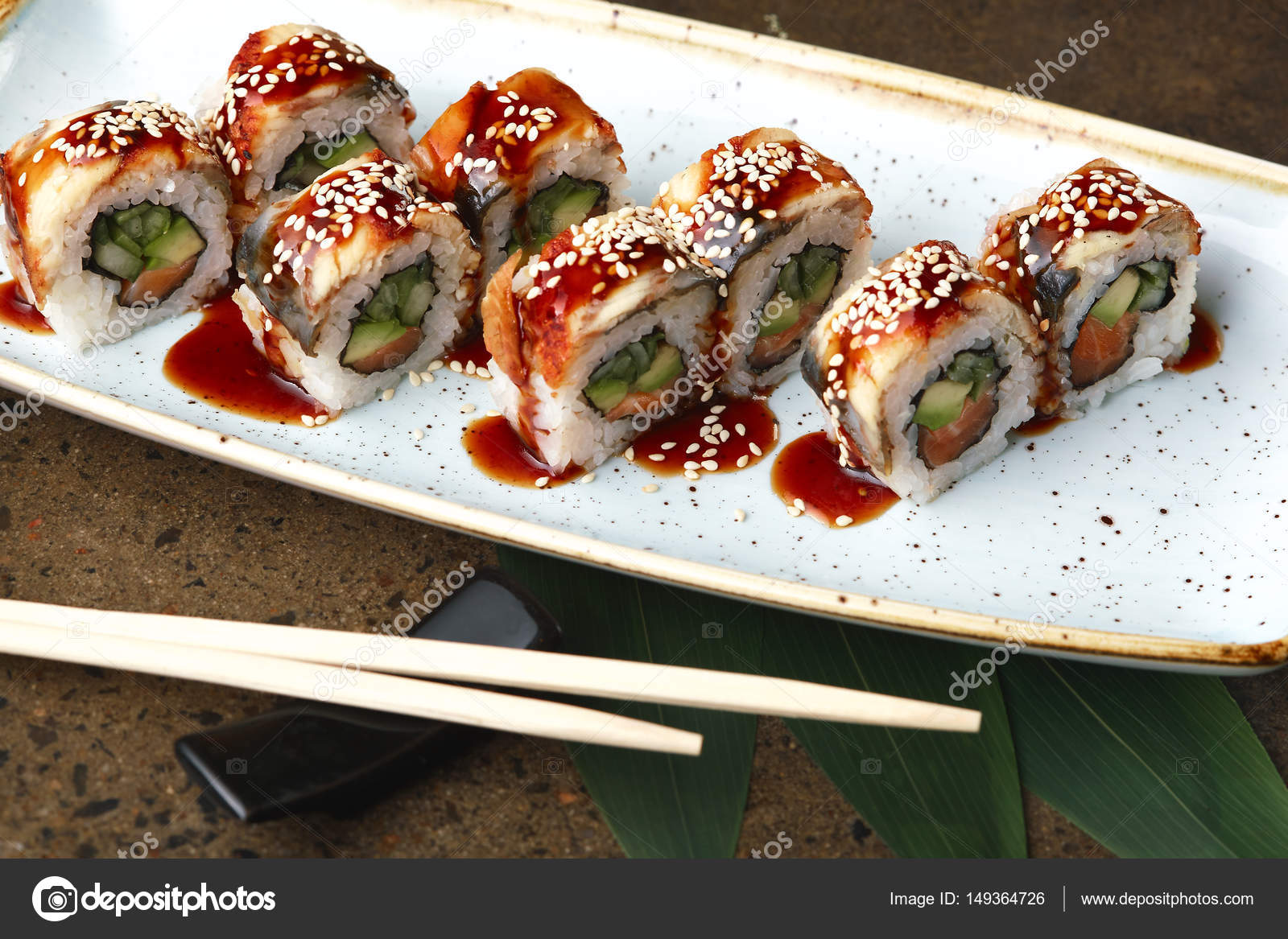 Blue Fish Sushi | Sushi Roll With Fish In A Beautiful Blue Plate Stock Photo