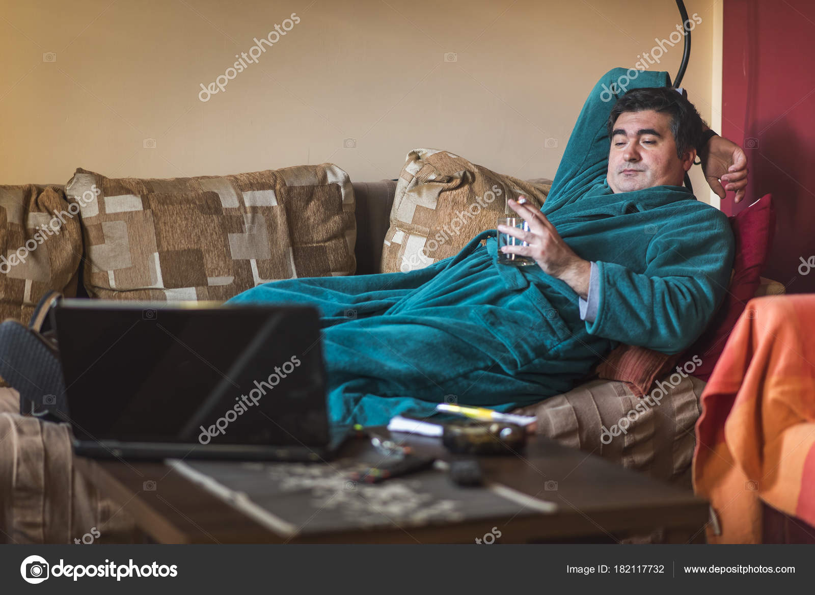 Lazy Mature Obese Man Stock Photo