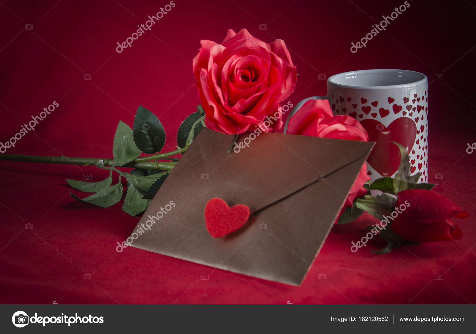 valentine concept love letter rose and a heart cup on a red background
