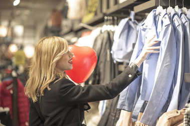 Beautiful woman shopping for clothes