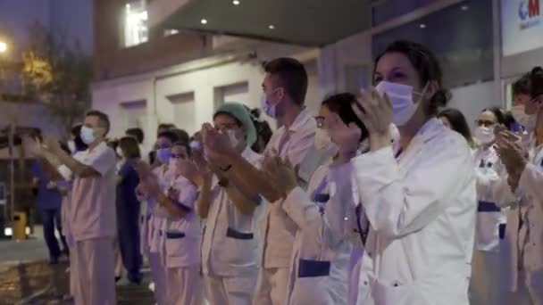 Medical staff from Fundacion Jimenez Diaz hospital who are fighting coronavirus applaud back the people of Madrid and police officers for their support