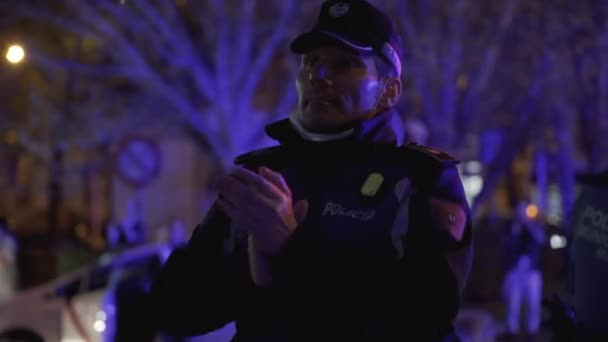 Madrid Municipal Police officer applauds medical workers from the Fundacion Jimenez Diaz hospital who are fighting coronavirus
