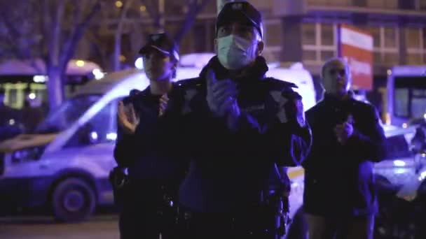 Some Madrid Municipal Police officers applaud medical workers from the Fundacion Jimenez Diaz hospital who are fighting coronavirus