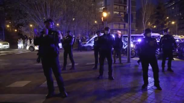 A group of Madrid Municipal Police officers applaud medical workers from the Fundacion Jimenez Diaz hospital who are fighting coronavirus