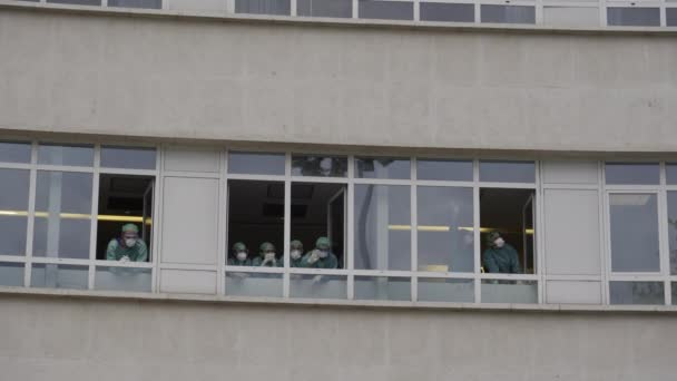 Medical staff from Fundacion Jimenez Diaz hospital who are fighting coronavirus wave their hands out of the windows to thank back the people of Madrid for their support