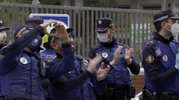 Several Madrid Municipal Police officers applaud and cheer up medical workers from Fundacion Jimenez Diaz hospital who are fighting coronavirus