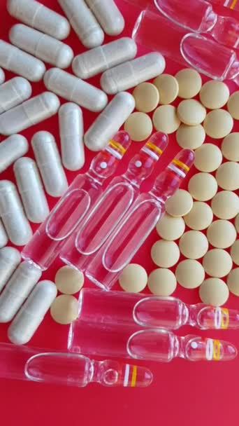 Macro ampules drugs and pills on a red background
