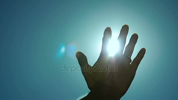 Abstract Sun Rays Through Female Fingers Palm