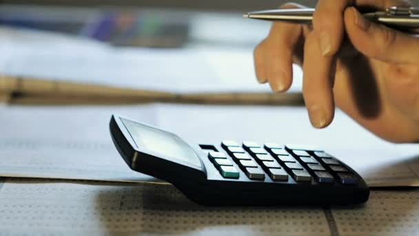 Female Hand Accountant Counts the Balance in the Office on a Calculator