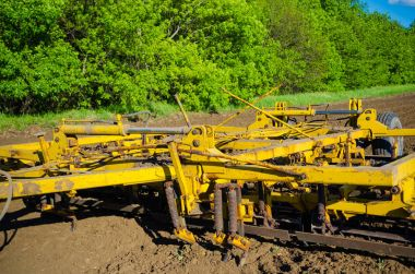 Large plow for soil at agricultural field