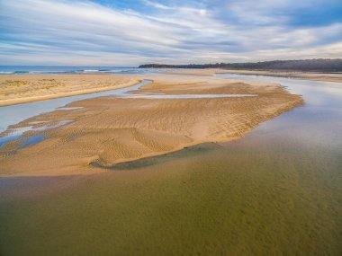 Aerial view of ocean coastline in Australia at low tide with copy space. Shallow turquoise water and sand.