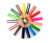 different colored wax crayons arranged together making a beautiful circle within a circled frame
