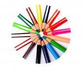 různé barevné vosk pastelky uspořádány dohromady, takže krásný kruh v kruhovém rámu