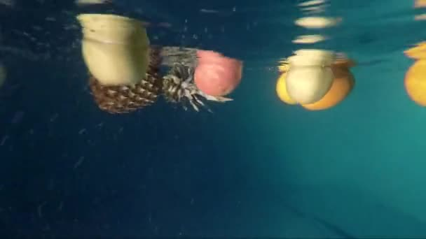 Fresh Fruit being shot as they submerged under water.