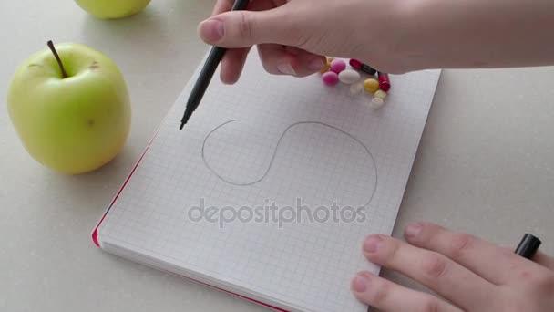 A mans hand draws a dollar sign near medical pills. Medicine and business