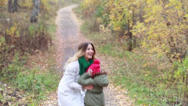 Happy family on a walk in the autumn forest