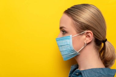 Side view of young woman in medical mask on yellow background, coronavirus concept stock vector