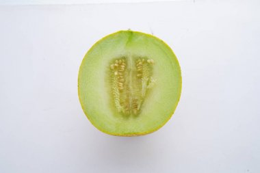 A fresh melon with one slice cut out stock photo