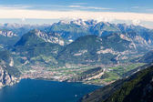 Photo Lago di Garda, Torbole and Riva del Garda. Mountains in backgrou