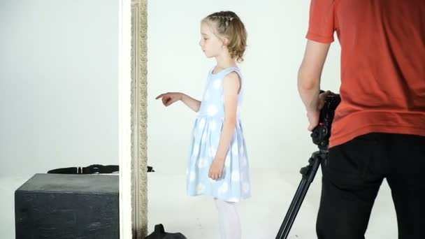 Little girl in the process of video clip shooting