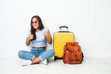 Young mixed race indian woman ready to go to travel raising both thumbs up, smiling and confident.