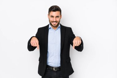 Young caucasian business man against a white background isolated points down with fingers, positive feeling.