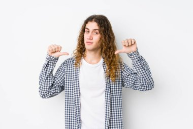 Young long hair man posing isolated feels proud and self confident, example to follow.