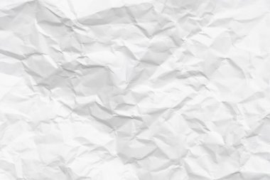 Modern crumpled white paper on empty sheet gray background with light shadows for creative wallpaper, card, art work design