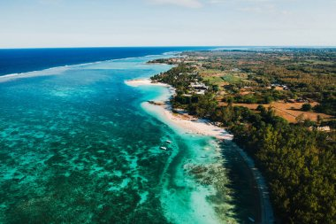 Aerial photography of the East coast of the island of Mauritius. Flying over the turquoise lagoon of Mauritius in the Belle Mare area.Coral reef of Mauritius. Mauritius Island Beach.