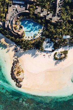 Aerial picture of the east coast of Mauritius Island. Flying above the turquoise lagoon of Mauritius in the region of Belle Mare