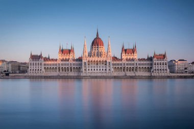 The Hungarian Parliament Building on the bank of the Danube at the sunset in Budapest