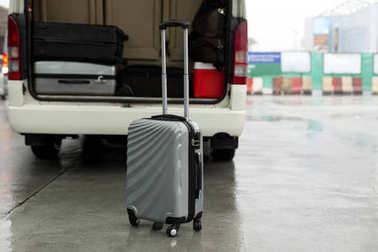 Luggage stand on the road and arrange on the van for a trip
