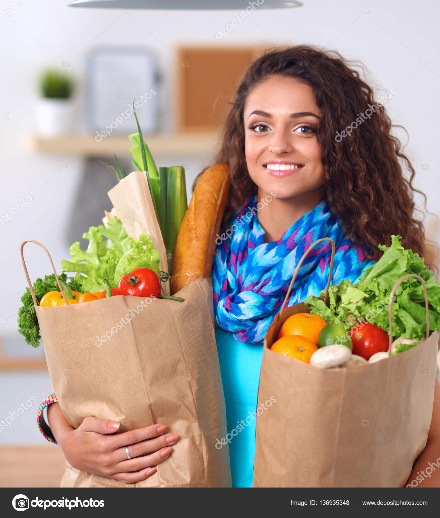 Young woman holding grocery shopping bag with vegetables .Standing ...